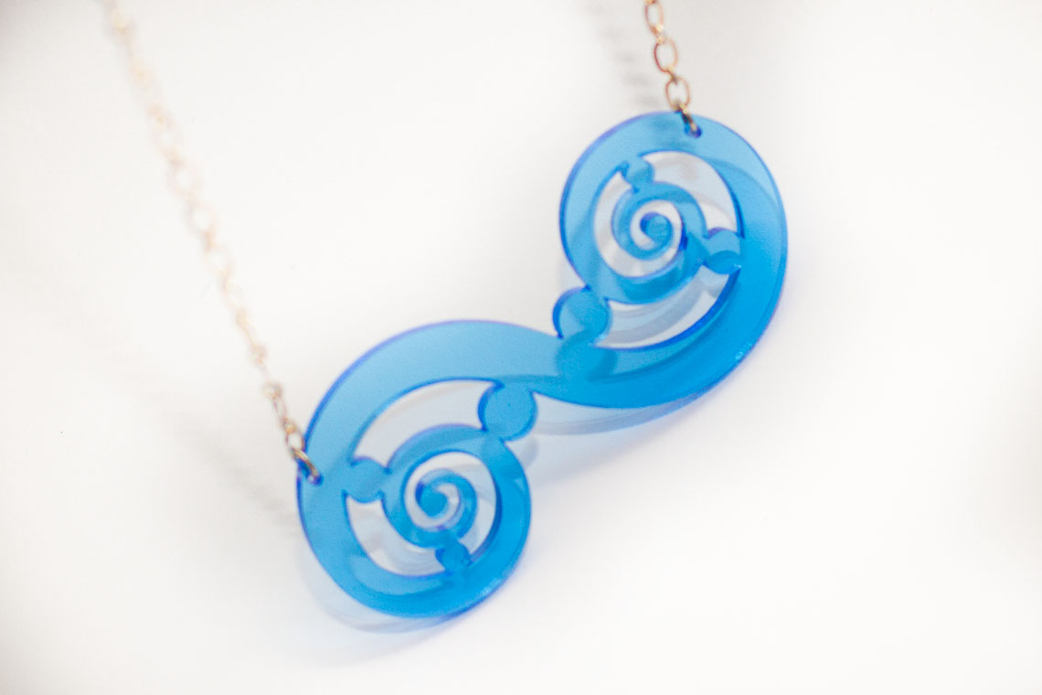Pen and Process: Elegant Laser Cut Blue Acrylic Necklace